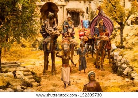 Three wise man arriving bethlehem - stock photo