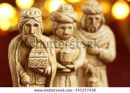 Three wise men from nativity scene. Gypsum figurines. Selective focus, shallow DOF - stock photo