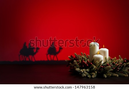 Three wise men on the way to Jesus in Bethlehem and candles - stock photo
