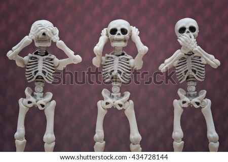 Three wise skeletons - stock photo
