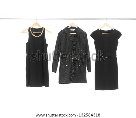 Three woman black clothes on a hanger studio isolated - stock photo