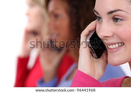 Three woman chatting over the phone. - stock photo