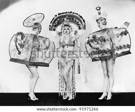 Three woman in ornate teapot costumes