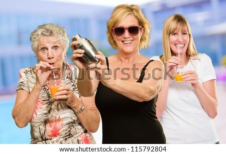 Three Women Enjoying The Drink, Outdoor - stock photo