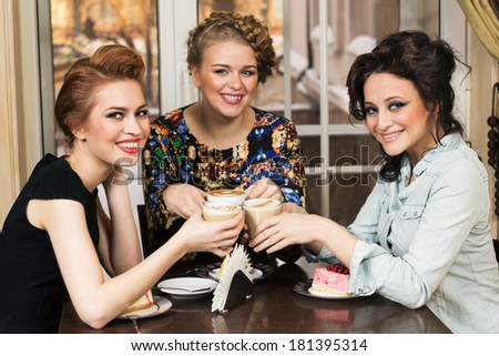 Three women friends in cafe