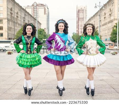 Three women in irish dance dresses posing  - stock photo