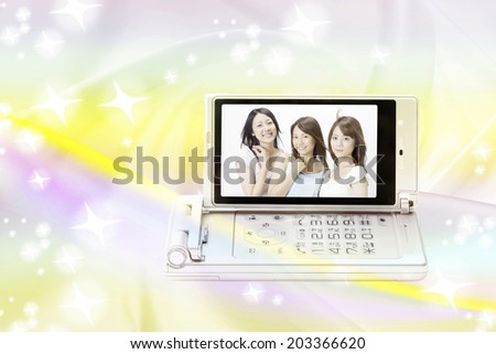 Three Women Reflected In Mobile Screen