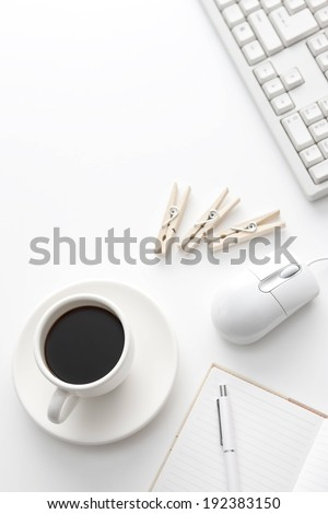 Three wooden clippers lying next to a mouse and cup of black tea. - stock photo