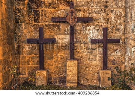 three wooden crosses on Mount Golgotha