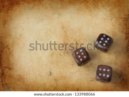 Three wooden dices on a vintage background - gambling lucky streak concept with free text space