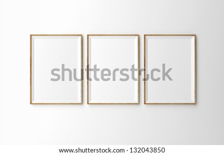 three wooden frames on white wall - stock photo
