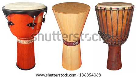 Three wooden jembe drums isolated on white background - stock photo