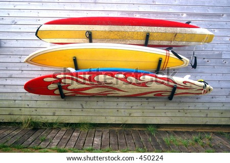 three worn surfboards hanging on the house Ditch Plains Montauk New York - stock photo