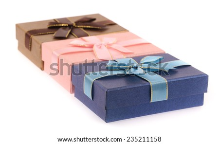 Three wrapped gifts isolated on white background