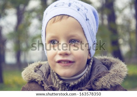 three year boy in park, autumn