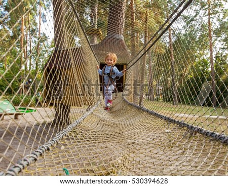 stock photo three year girl the blonde with a personal fall arrest system obstacle in the rope town little 530394628 fall arrest stock images, royalty free images & vectors shutterstock  at gsmx.co