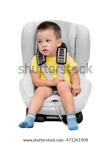 Three-year-old boy sits in an automobile children's chair, isolated, on the white