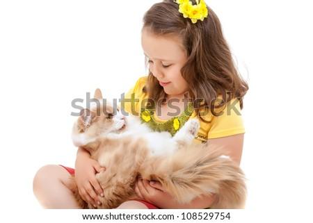 three year-old girl holding a kitten. - stock photo
