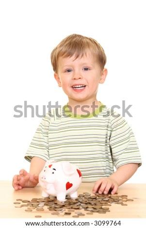 three years boy and piggy bank isolated on white