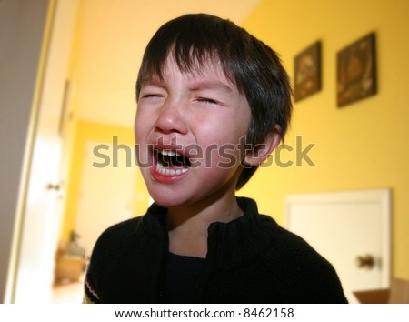 Three years old boy having tantrum - stock photo