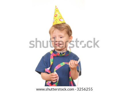 three years old boy in party hat isolated on white