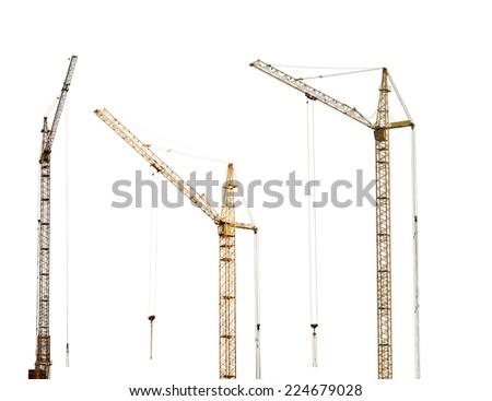 three yellow hoisting cranes isolate on white background - stock photo