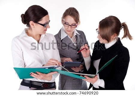 three young and beautiful business women discuss portfolio, on white background - stock photo