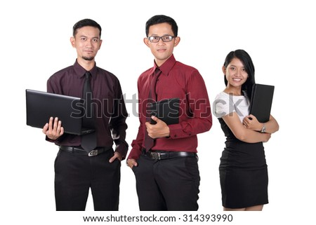 Three young Asian office workers standing and posing to camera confidently, isolated on white background - stock photo