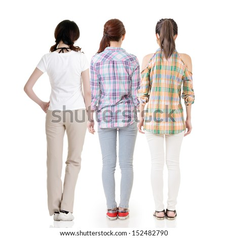 Three young asian pretty women standing back to camera. Full length. Rear view. Isolated on the white background.