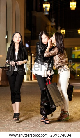 Three young asian woman shopping - stock photo