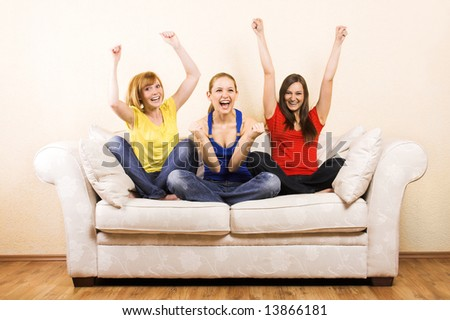 Three young beautiful women are cheering on a lounge - stock photo