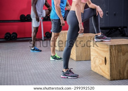 Three young Bodybuilders doing exercises in the  gym - stock photo