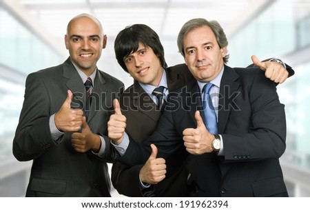 three young business men at the office - stock photo