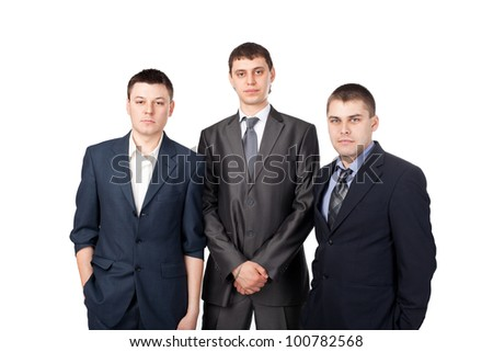 Three young business men standing isolated on white background - stock photo
