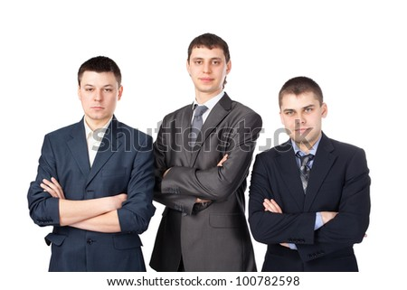 Three young business men standing with folded hands isolated on white background