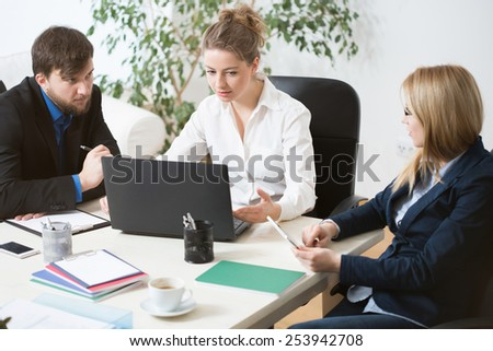 Three young businesspeople working in a team - stock photo