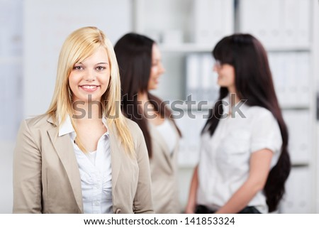 three young businesswomen talking in the office - stock photo