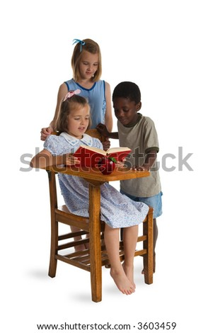 Three young children of different races reading together at a wooden school desk. Isolated on a white. - stock photo