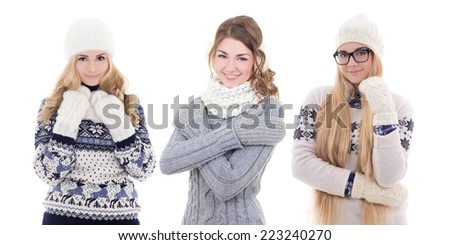 three young cute women in warm winter clothes isolated on white background - stock photo