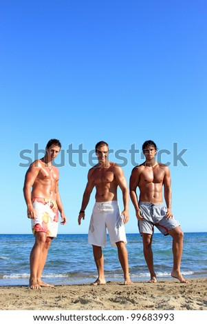 Three Young friends Relaxing On the Beach