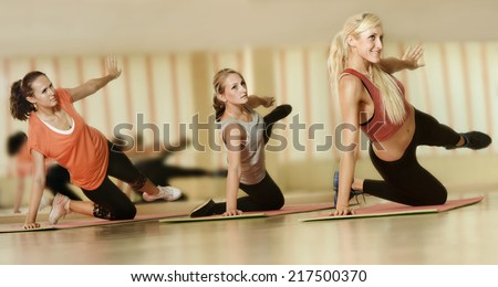 three young girls go in for sports in a gym - stock photo