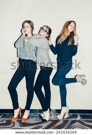 Three young girls  having fun. Trendy teenagers posing hipsters Toned - stock photo