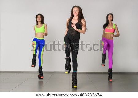 Three young girls jumping on kangoo training