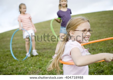 Three young girls playing - stock photo