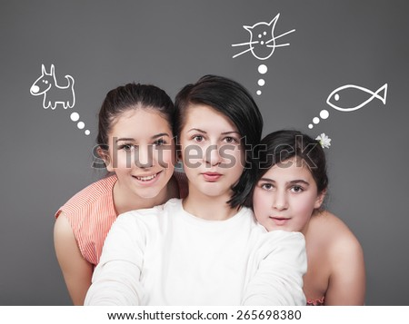 Three young girls wishes - stock photo