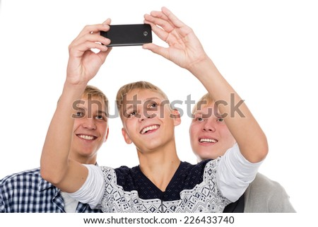 Three young men take on self smartphone.  - stock photo