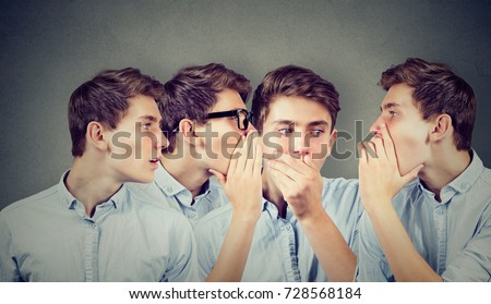 Three young men whispering each other and to shocked astonished guy in the ear. Word of mouth.