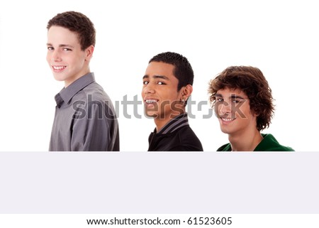 three young, of different colors man holding a white board, looking to camera, isolated on a white background - stock photo