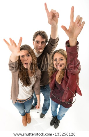 Three young people raising their hands - stock photo
