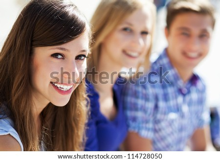 Three young people smiling - stock photo